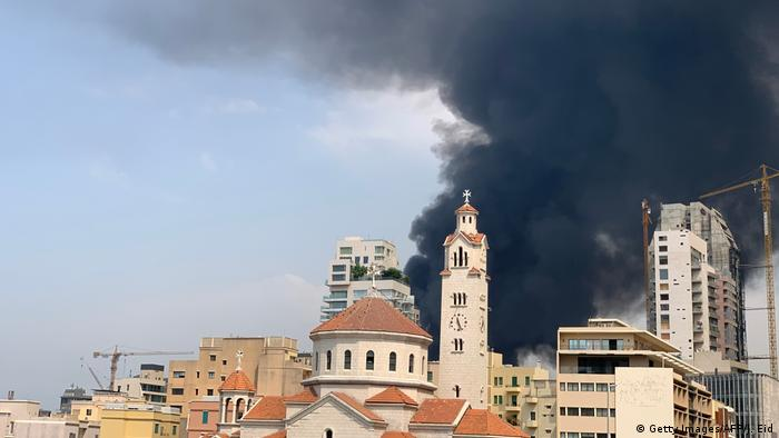 Smoke from a huge fire raging in Beirut port