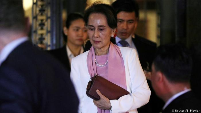 Aung San Suu Kyi leaves the International Court of Justice in 2019