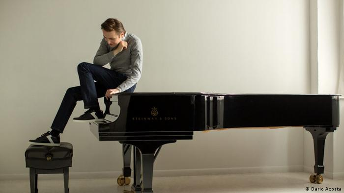 Daniil Trifonov sits not at, but on a grand piano (Dario Acosta)