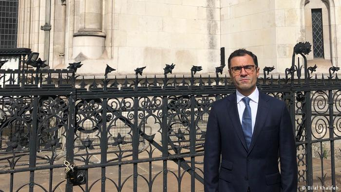 Bilal Khalifeh standing in front of the Royal Court of Justice in London