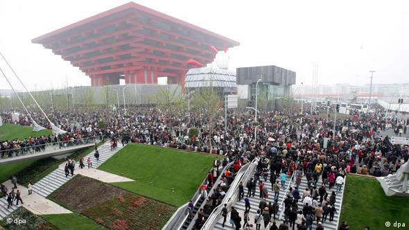 Crowds of visitors walk towards the China Pavilion in the Expo site in Shanghai, China.