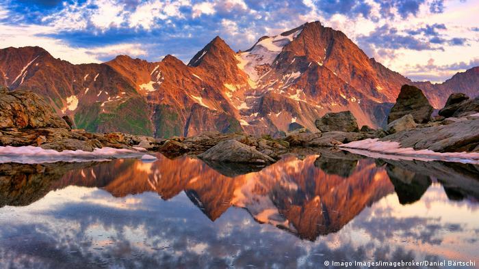 Reflection of the Oberalpstock in a mountain lake, Maderanertal, Canton Uri, Switzerland