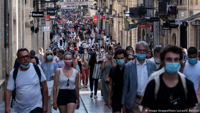 People wear face coverings while shopping in Bordeaux