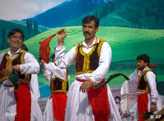 Pakistani Pashtuns perform a traditional dance