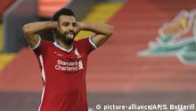 Liverpool's Mohamed Salah celebrates after he scored his side's fourth goal during the English Premier League soccer match between Liverpool and Leeds United, at the Anfield stadium, in Liverpool, Saturday, Sept. 12, 2020. (Shaun Botterill, Pool via AP)  