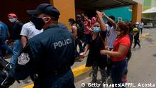 Nicaraguans wanting to return to their country amid the COVID-19 novel coronavirus pandemic protest at the National Transportation Terminal Albrook in Panama City, on August 12, 2020. - Hundreds of Nicaraguans who have run out of livelihoods in Panama had to postpone the return to their country due to the failure to comply with requirements agreed in the last hours by the Panamanian authorities to guarantee an orderly trip amid the ongoing pandemic. (Photo by Luis ACOSTA / AFP) (Photo by LUIS ACOSTA/AFP via Getty Images)