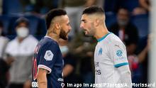 It is a photograph of the top halves of Neymar and Alvaro Gonzalez. The two players are facing off. Neymar wears a dark blue top on the left and Gonzalez wears a white top with blue neck and arm bands.