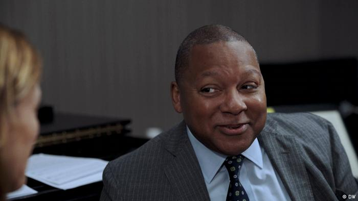 Wynton Marsalis smiling as he talks to an interview partner