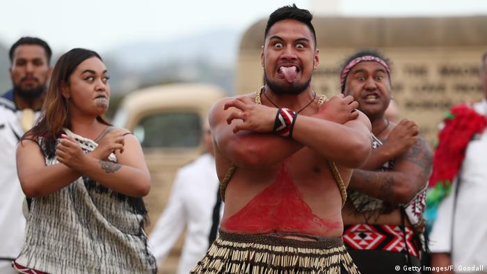 Local iwi perform a haka during an evening to commemorate Maori service in the NZ armed forces