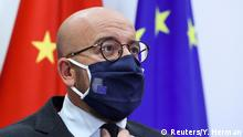 Charles Michel wears a dark blue EU-branded face mask