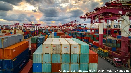A picture showing containers and cranes at the foreign trade container terminal of Qingdao port in China's Shandong province,