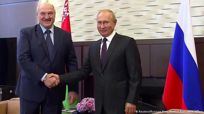 A picture showing Russia's President Vladimir Putin shaking hands with his Belarusian counterpart Alexander Lukashenko during a meeting in Sochi, Russia in September 2020