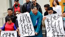Demonstrators, holding signs with Mongolian script, protest against China's changes to school curriculums that remove Mongolian language from core subjects, outside the Mongolian Ministry of Foreign Affairs in Ulaanbaatar, Mongolia August 31, 2020. Picture taken August 31, 2020. REUTERS/Anand Tumurtogoo NO RESALES. NO ARCHIVES.