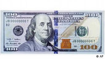 The new design of the $100 bill is shown after it was unveiled at the Treasury Department in Washington, Wednesday, April 21, 2010. The folks who print America's money have designed a high-tech makeover of the $100 bill, as part of an effort to stay ahead of counterfeiters as technology becomes more sophisticated and more dollars flow overseas, Federal Reserve Chairman Ben Bernanke says. (AP Photo/Manuel Balce Ceneta)