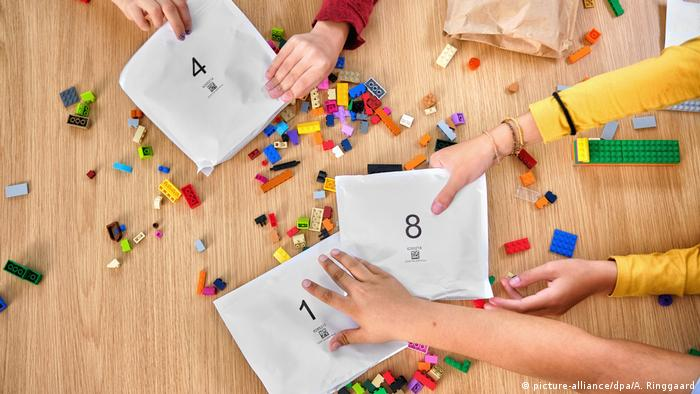 Lego toy pieces in paper bags