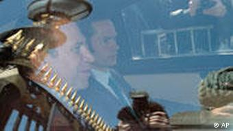 Premier Leterme in a car leaving the royal palace after meeting King Albert II