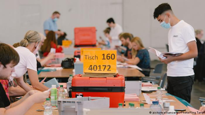 Volunteers count the votes in Cologne
