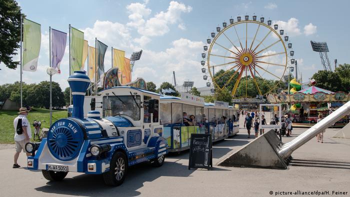 A fun fair train and Ferris wheel