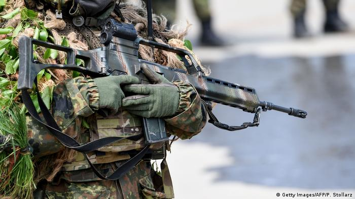 A German soldier holds a Heckler and Koch G36 rifle