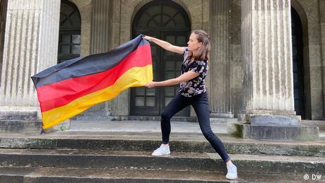Rachel Stewart holding a German flag (DW)