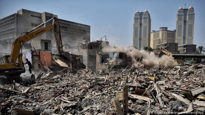The Fairmont hotel in Cairo, Egypt, in the background of a slum that is being destroyed
