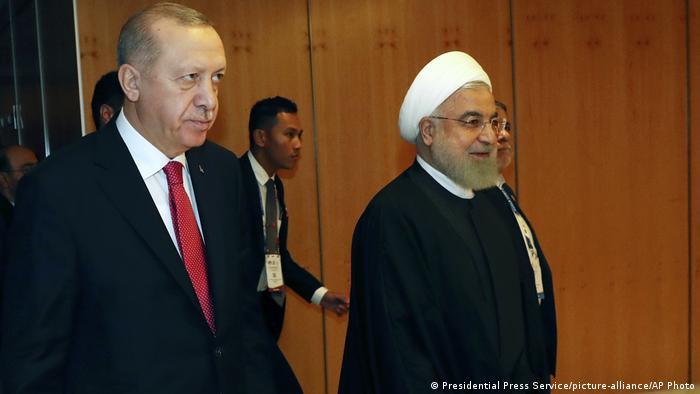 حلفاء للفلسطينيين؟ الرئيس التركي اردوغان (يسار) ونظيره الايراني روحاني