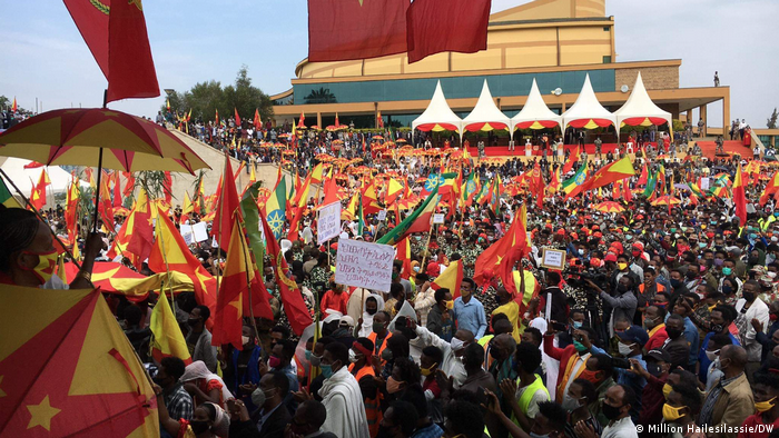 Hundreds of people holding TPLF flags march in the Tigray regional capital, Mekelle