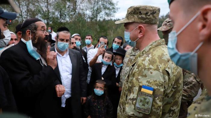 Ukraine's border service head Serhiy Deineko speaks with Jewish pilgrims