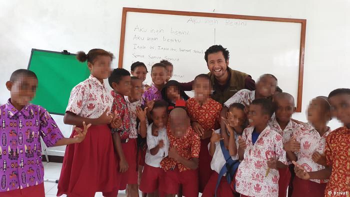 Radhiyan Pribadi with students in Papua province