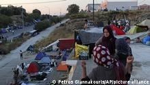 17.09.2020 *** Migrants stand on a rooftop of a building as others remained camped out on a road leading from Moria to the capital of Mytilene, on the northeastern island of Lesbos, Greece, Thursday, Sept. 17, 2020. Fires swept through the overcrowded camp at Moria on two nights last week, prompting more than 12,000 migrants and refugees to flee. Most of them remain without shelter even though emergency tents are available at another island site where a new camp is being built. (AP Photo/Petros Giannakouris) |