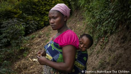 Vanessa Ntakirutimana from Rwanda carrying her one and a half year old son on her back (Dominic Nahr/Save The Children)