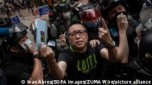 May 24, 2020, Hong Kong, China: Pro-democracy politician, Tam Tak-chi being arrested by Hong Kong police during demonstrations against the draft bill. Hong Kong police fired teargas and pepper spray onto demonstrators after thousands took to the streets in Causeway Bay protesting against Beijing's declaration that it intends to impose national security laws. (Credit Image: © Ivan Abreu/SOPA Images via ZUMA Wire |