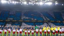 The teams line up prior to the UEFA Europa League semi final first leg soccer match between HSV Hamburg and Fulham FC in Hamburg, Germany, Thursday, April 22, 2010. (AP Photo/Gero Breloer)