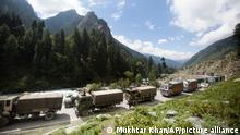 """An Indian army convoy moves on the Srinagar- Ladakh highway at Gagangeer, northeast of Srinagar, Indian-controlled Kashmir, Tuesday, Sept. 1, 2020. India said Monday its soldiers thwarted """"provocative"""" movements by China's military near a disputed border in the Ladakh region months into the rival nations' deadliest standoff in decades. China's military said it was taking """"necessary actions in response, without giving details. (AP Photo/Mukhtar Khan)"""
