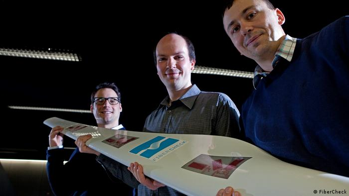 FiberCheck managers holding a rotor blade