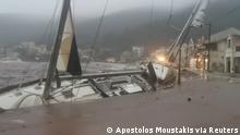 A boat is battered against a harbor wallk during storm Ianos (Apostolos Moustakis via Reuters)