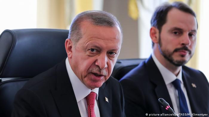 President Erdogan sits alongside his son-in-law and Finance Minister Berat Albayrak