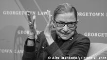 FILE - In this April 6, 2018, file photo, Supreme Court Justice Ruth Bader Ginsburg applauds after a performance in her honor after she spoke about her life and work during a discussion at Georgetown Law School in Washington. The Supreme Court says Ginsburg has died of metastatic pancreatic cancer at age 87. (AP Photo/Alex Brandon, File) |