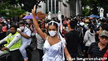 19.09.2020 *** A pro-democracy protester holds up the three-finger salute during an anti-government rally at Thammasat University in Bangkok on September 19, 2020. - A youth-led pro-democracy movement made a stand in Bangkok on September 19, with protesters calling for Prime Minister Prayut Chan-O-Cha to step down and demanding reforms to the monarchy. (Photo by Lillian SUWANRUMPHA / AFP)