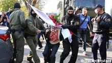 Belarus security forces detain an elderly woman during protests in Belarus