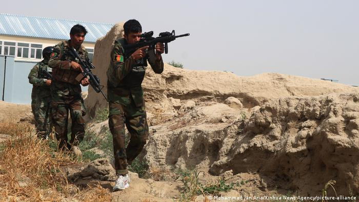 Afghanistan ANDSF fighters with machine guns in the desert