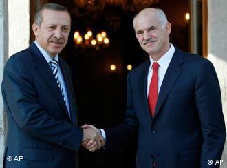 Greek Prime Minister George Papandreou, right, and his Turkish counterpart Recep Tayyip Erdogan shake hands.