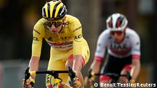 Cycling - Tour de France - Stage 21 - Mantes-la-Jolie to Paris Champs-Elysees - France - September 20, 2020. UAE Team Emirates rider Tadej Pogacar of Slovenia, wearing the overall leader's yellow jersey, in action. REUTERS/Benoit Tessier