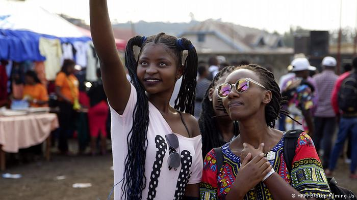 Human Rights Film Festival 2020: image from the film Stop Filming Us. Two young, fashionably dressed black women at a market (HRFFB/Stop Filming Us)