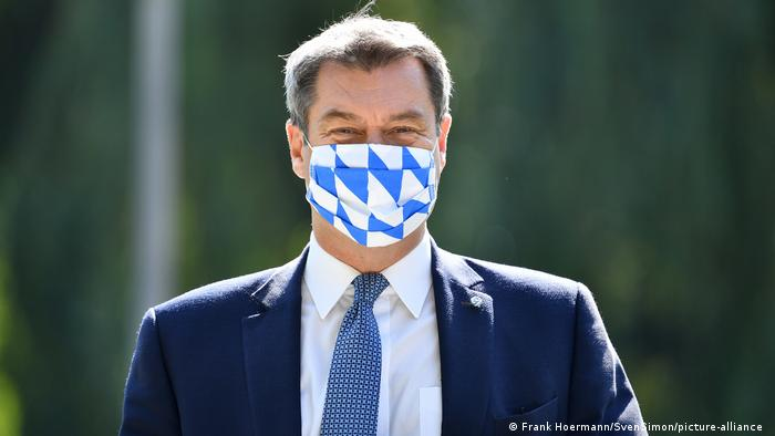 Markus Söder wearing a face mask in the pattern of the Bavarian flag