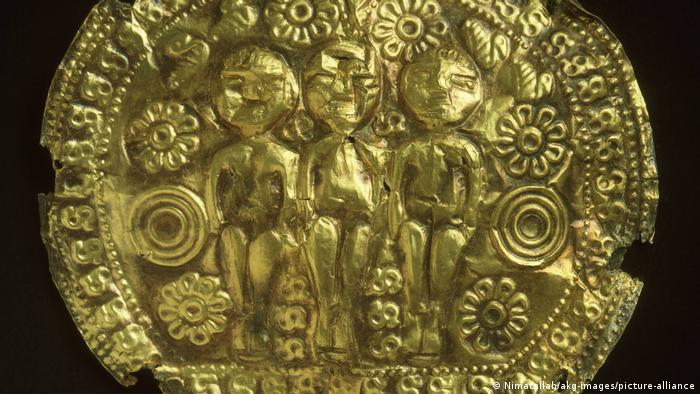 A piece of jewelry from ancient Rome depicting three figures