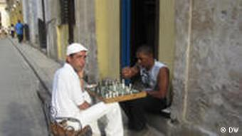 Men playing chess on the street in Cuba