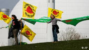 Anti-nuclear advocates form a human chain at a power plant in northern Germany