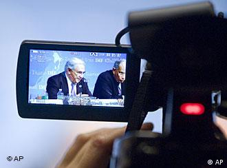 Dominique Strauss-Kahn, IMF Managing Director, left, and Youssef Boutros-Ghali, Chairman of the International Monetary and Financial Committee are seen in a television camera monitor, while they talk with media during a press conference at the end of the second day of the G-20 Meeting of Finance Ministers and Central Bank at the World Bank headquarters in Washington, Saturday, April 24, 2010. (AP Photo/Cliff Owen)