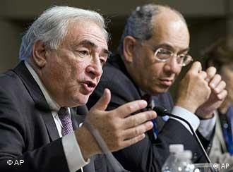 International Monetary Fund Managing Director Dominique Strauss-Kahn, left, and Youssef Boutros-Ghali, Chairman of the International Monetary and Financial Committee, speak during at a press conference at the end of the second day of the G-20 meeting of finance ministers and central bank governors at the World Bank headquarters in Washington Saturday, April 24, 2010. (AP Photo/Cliff Owen)